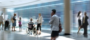 elderly persons on a wheelchairs and guests in the hospital lobb